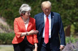 British Prime Minister Theresa May walks with President Donald Trump prior to a joint press conference at Chequers, in Buckinghamshire, England, July 13, 2018.