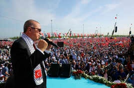 Turkish President Recep Tayyip Erdogan addresses a rally in solidarity with Palestinians before an extraordinary summit of the Organization of Islamic Cooperation (OIC), in Istanbul, Turkey, May 18, 2018.