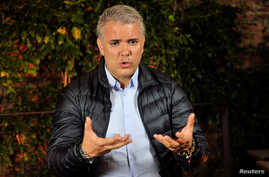 Colombian presidential candidate of the Democratic Center party Ivan Duque gestures during an interview with Reuters in Bogota, Colombia, June 11, 2018.