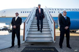 U.S. Secretary of State John Kerry arrives at Stansted Airport outside of London, where he is expected to attend meetings on Syria with the London 11, May 14, 2014.