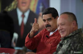 Venezuela's President Nicolas Maduro gestures during a TV show with National Constituent Assembly member Diosdado Cabello in Caracas, Venezuela, April 11, 2018.
