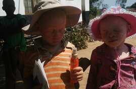 Children with albinism in Malawi are strongly advised not to walk unaccompanied by an elder. (L. Masina/VOA)