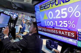 The rate decision of the Federal Reserve is shown on a television on the floor of the New York Stock Exchange, June 14, 2017.
