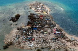 An aerial view of a coastal town, devastated by super Typhoon Haiyan, in Samar province in central Philippines November 11, 2013.