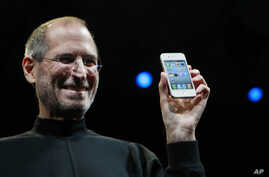 FILE - Apple CEO Steve Jobs smiles with a new iPhone at the Apple Worldwide Developers Conference in San Francisco. In the white-hot competition for tech talent, some workers are alleging Silicon Valley's top companies conspired to keep employees fro...