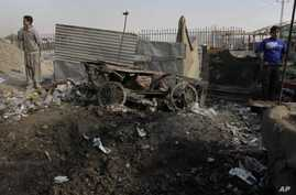Afghan boys stand at the scene where a rocket landed in Kabul, Afghanistan, November 17, 2011.