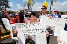 A crowd protests outside the Broward County supervisor of elections office, Nov. 9, 2018, in Lauderhill, Fla.