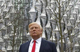 A Madame Tussauds wax figure of US President Donald Trump stands outside the new US Embassy in Embassy Gardens in south-west London on Jan. 12, 2018.