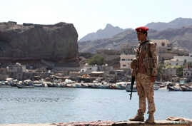 A soldier allied to Yemen's internationally recognized government stands guard at the fish market in Aden, Yemen, Dec. 13, 2018.