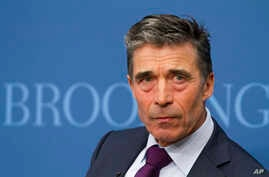 North Atlantic Treaty Organization (NATO) Secretary General Anders Fogh Rasmussen listens to a question while speaking about the future of NATO at The Brookings Institution in Washington, March 19, 2014.