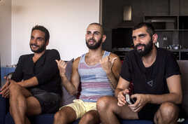 """This July 27, 2015 photo shows Khader Abu Seif, from left, Naeem Jiryes and Fadi Daeem, protagonists of the documentary movie """"Oriented"""" during an interview with The Associated Press in Jaffa, mixed Jewish-Arab part of Tel Aviv, Israel."""