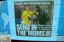 Screen grab from CBS News report on Toya Graham the Baltimore mom who pulled her son away from the rioting.