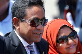 FILE - Maldives President Yameen Abdul Gayoom, accompanied by his wife Fathimath Ibrahim, arrives in Colombo, Sri Lanka, July 22, 2015.