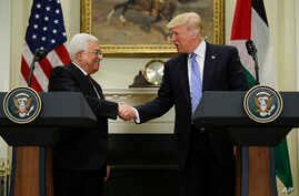 President Donald Trump shakes hands with Palestinian leader Mahmoud Abbas after their statements in the Roosevelt Room of the White House in Washington, May 3, 2017.
