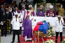 Bishop Joseph Lafontant incenses the coffin containing the remains of former President Rene Preval during his funeral service in Port-au-Prince, Haiti, March 11, 2017.