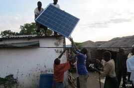 Solar collector panel is installed on roof in rural Phalombe district of Malawi. (VOA/Lameck Masina)