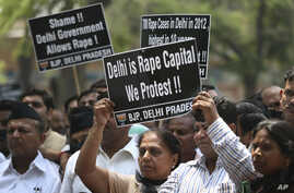 Indian protesters hold placards during a protest to demand for tougher rape laws and better police protection for women, outside the Parliament in New Delhi, India, April 22, 2013.