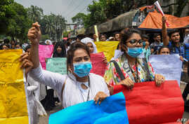 Bangladeshi students march along a street during a student protest in Dhaka, Aug. 4, 2018, following the deaths of two college students in a road accident. Parts of the Bangladeshi capital ground to a halt for the seventh day as thousands of students
