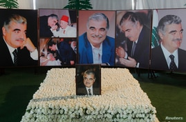 Pictures of Lebanon's assassinated former prime minister Rafik al-Hariri are seen at his grave site in downtown Beirut, Jan. 16, 2014.