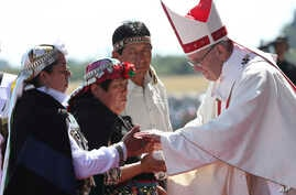 Pope Francis greets Mapuches in an offertory of a Mass at the Maquehue Air Base, in Temuco, Chile, Jan. 17, 2018.