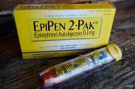 FILE - An EpiPen epinephrine auto-injector, a Mylan product, is displayed in Hendersonville, Texas, Oct. 10, 2013.