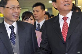 Chinese Official Seeks Business, Friends in Taiwan Despite Risks