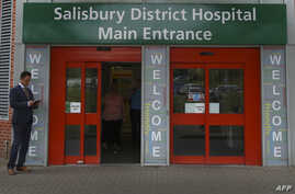 FILE - A general view shows the main entrance to Salisbury District Hospital, in Salisbury, southern England, July 04, 2018, where a British woman, Dawn Sturgess, poisoned with a nerve agent, died Sunday.