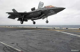 FILE  - A Lockheed Martin F-35B Lightning II Joint Strike fighter jet touches down on the amphibious assault ship USS Wasp in the Indo-Asian-Pacific region in East China Sea, March 5, 2018.