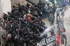 Police use pepper spray on protesters in Washington, Friday, Jan. 20, 2017, in a chaotic confrontation blocks from Donald Trump's inauguration as protesters registered their rage against the new president.
