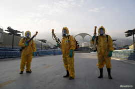 Municipal workers wait before spraying insecticide at Sambodrome in Rio de Janeiro, Brazil, Jan. 26, 2016.