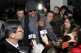 Flamboyant former NBA star Dennis Rodman is surrounded by journalists upon arrival at Pyongyang Airport, North Korea, Feb. 26, 2013.