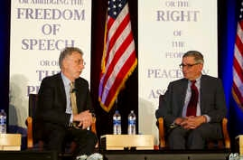 First Martin Baron, left, executive editor of the Washington Post, speaks as David Shribman, executive editor of the Pittsburgh Post-Gazette, listens at the National First Amendment Conference in Pittsburgh, Pennsylvania, Oct. 22, 2018.
