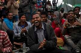 Migrants enjoy a music performance aboard of Golfo Azurro rescue boat a day after being rescued by members of Proactiva Open Arms NGO, April 7, 2017.