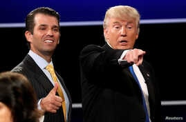 FILE - Donald Trump Jr. (L) gives a thumbs up beside his father Republican U.S. presidential nominee Donald Trump (R) after Trump's debate against Democratic nominee Hillary Clinton at Hofstra University in Hempstead, New York, Sept, 26, 2016.