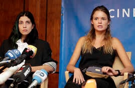 Pussy Riot member and the former wife of Pyotr Verzilov, Nadya Tolokonnikova, left, and Verzilov's girlfriend Veronica Nikulshina address the media during a press conference on the state of health of the member of the Russian Punk band Pussy Riot, Py...