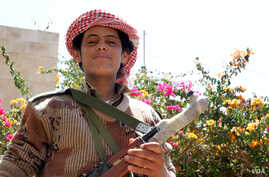 Febuary 19, 2012 - One year after the Arab Spring hit Yemen, youths on both sides are hopeful. (E. Arrott/VOA)