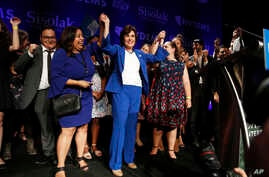 Rep. Jacky Rosen, D-Nev., center, celebrates at a Democratic election night party after wining a Senate seat, Nov. 7, 2018, in Las Vegas.