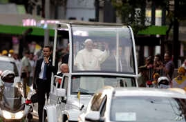 Pope Francis waves to the crowds after his arrival in Santiago, Chile, Jan. 15, 2018.