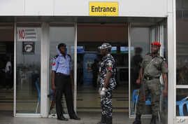Police officers stand guard at the departure hall of Murtala Muhammed International Airport in Lagos, Nigeria, Aug. 4, 2014.