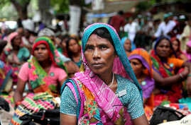 Indian women farmers gather near the Indian parliament for a protest against the Land Acquisition Bill in New Delhi, India, July 24, 2015.