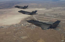 Three F-35 Joint Strike Fighters fly over Edwards Air Force Base in this Dec. 10, 2011 handout photo provided by Lockheed Martin.
