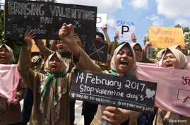Muslim students shout slogans during a protest against Valentine's Day celebrations in Surabaya, Indonesia, Feb. 13, 2017 in this photo taken by Antara Foto.