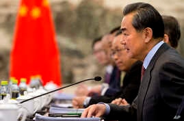 Chinese Foreign Minister Wang Yi speaks during his meeting with U.S. Secretary of State John Kerry at the Ministry of Foreign Affairs in Beijing, Jan. 27, 2016.