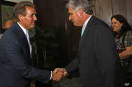 Sen. Jeff Flake, R-Ariz, shakes hands with Cuba's First Vice President Miguel Diaz Canel, at Revolution Palace, in Havana, Cuba, June 13, 2015.