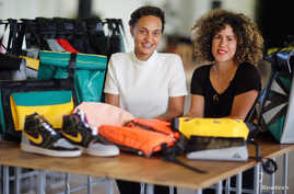 The founders Nora Azzaoui and Vera Guenther are pictured at their non-profit organization Mimycri, which recycles parts of a discarded dinghies into bags, in Berlin, Germany, July 23, 2018.