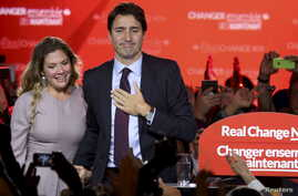 Liberal Party leader Justin Trudeau stands with his wife, Sophie Gregoire, as he gives his victory speech after Canada's federal election in Montreal, Quebec, Oct. 19, 2015.