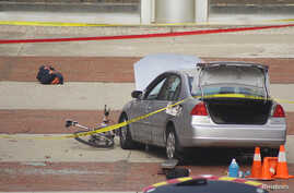 A car which police say was used by an attacker to plow into a group of students is seen outside Watts Hall on Ohio State University's campus in Columbus, Ohio, Nov. 28, 2016. (Courtesy of Mason Swires/thelantern.com)