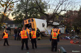 Rescue officials at the scene of a school bus crash involving several fatalities in Chattanooga, Tennessee, Nov. 21, 2016.