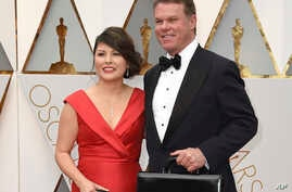 FILE - Accountants Martha Ruiz and Brian Cullinan from PricewaterhouseCoopers are pictured at the Oscars in Los Angeles, Feb. 26, 2017.