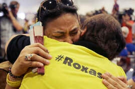 Supporters of Philippine presidential candidate Mar Roxas grieve as they attend his press conference in suburban Quezon city , north of Manila, Philippines on Tuesday, May 10, 2016.